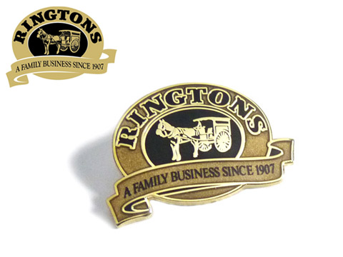 Metallic gold coloured enamel badges to give a traditional look.