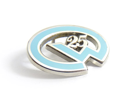 Personalised enamel badges custom made for the World Transport Agency Ltd .
