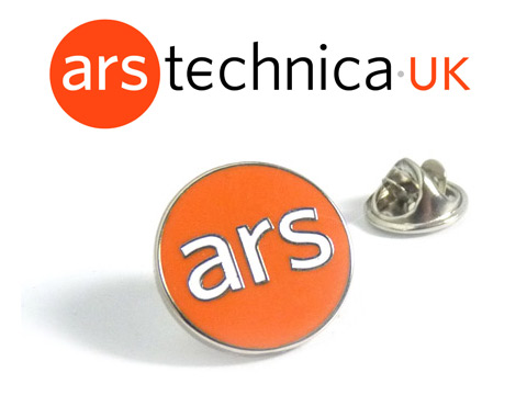 ARS custom corporate enamel pin badges made with orange and white enamel.