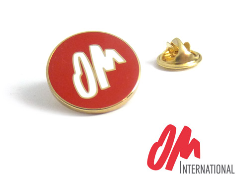 OM custom gold plated metal and red and white enamel badges.
