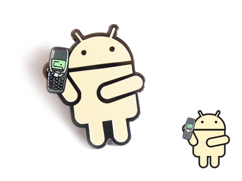 Five different coloured hard enamel pin badges custom made with Googles android character and Nokias mobile phone