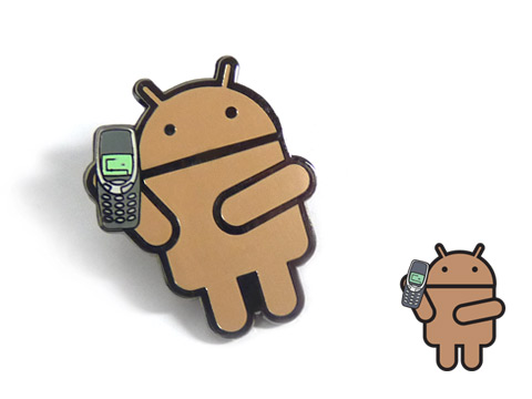 Custom android enamel badges made with coloured skin tones