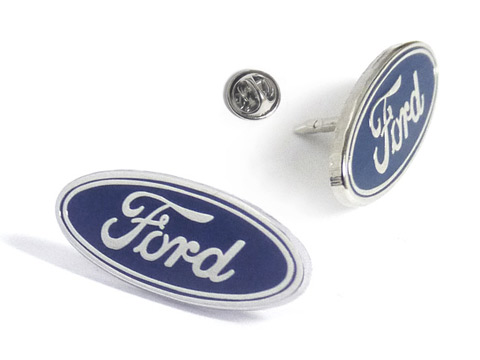 Branded Ford enamel badges photographed from different angles