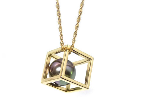 bespoke gold cube pendant with black pearl encased